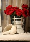 Bucket of red roses with seashell